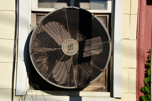 Fan on side of building Sand Hill Antiques and Refinishing.  Photo by Mike Hartley