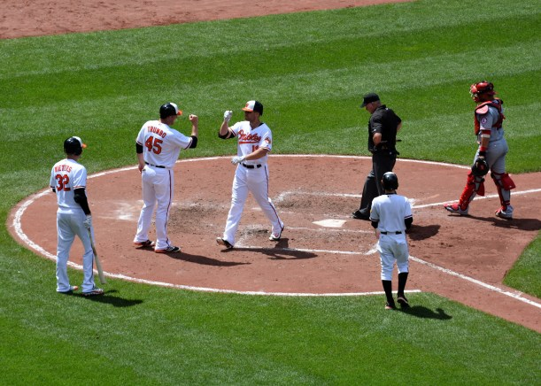 Chris Davis crosses home after a 2 run shot in the 4th. Photo by Mike Hartley