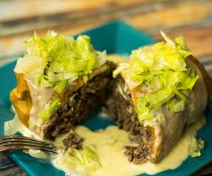 Beef and Bean Chimichangas topped with a delicious queso sauce.