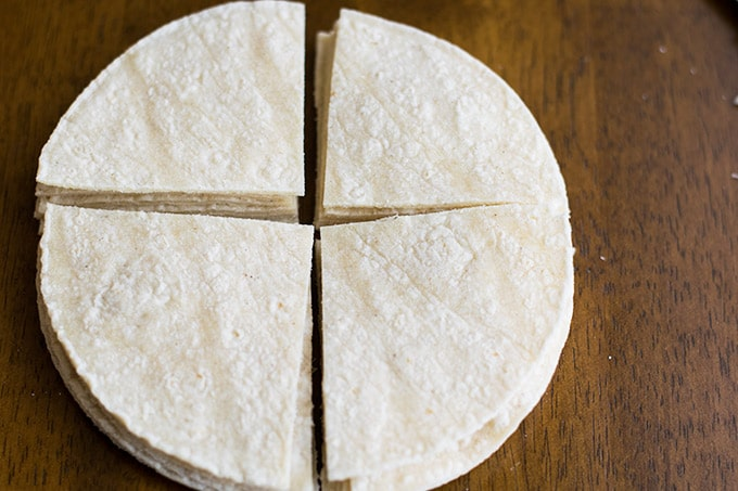 corn tortillas cut into four equal sized triangles