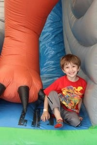 blonde boy in bounce house
