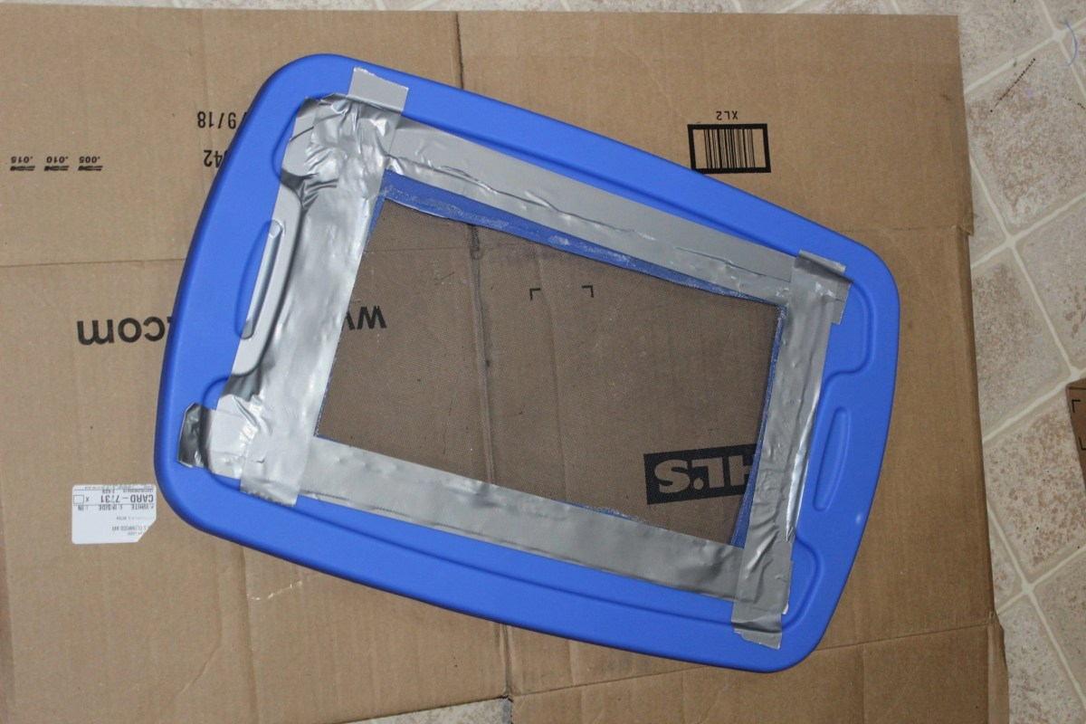 tote lid cut with duct tape