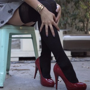 Legs in black thigh socks and dark red heels