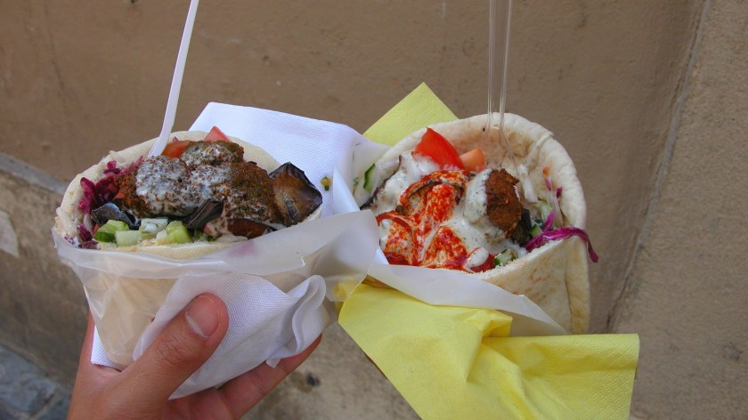 Two different falafels in hand