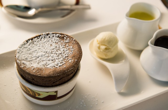 A guest favorite, Palo's signature Chocolate Souffle is served with decadent Vanilla Bean and Chocolate Sauces. (Ryan Wendler, photographer)