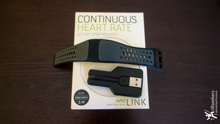 Mio LINK, out of the box, with USB charger, flexible silicone wristband with optical sensor attached
