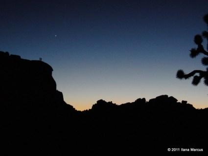 Climbers atop Intersection Rock at Sundown