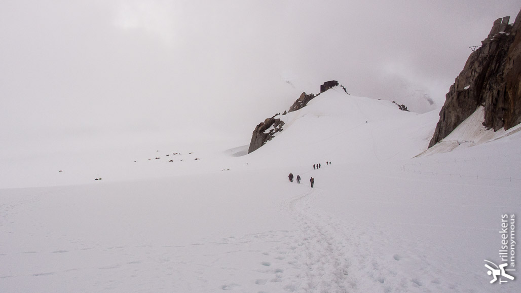 Approaching the Cosmiques Hut (center right) from the Aiguille du Midi with the campers on the glacier (left).