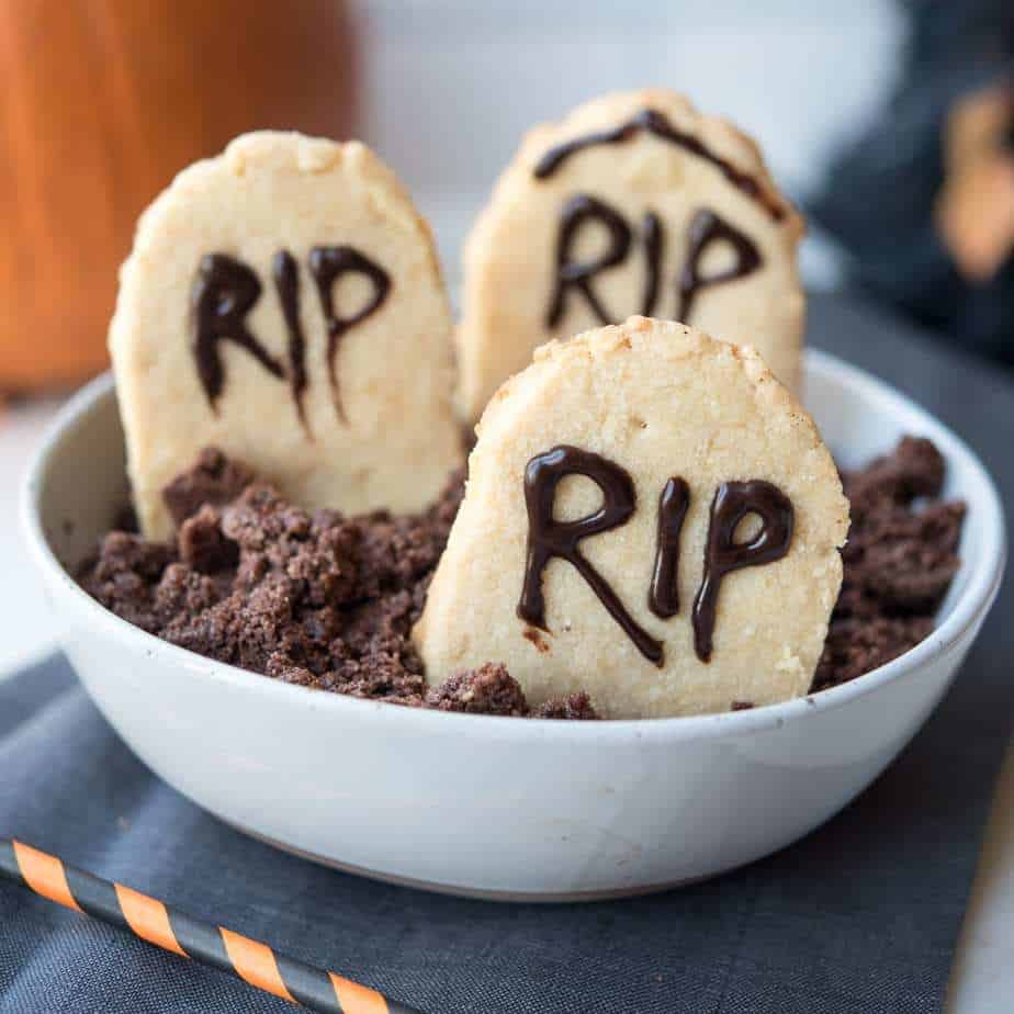 "Paleo Halloween Tombstone Cookies in gluten-free ""dirt"" in a white bowl"