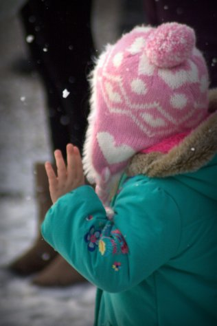 little girl touching snow 3
