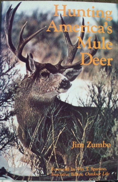 A photograph of the front cover of the dustjacket of the book Hunting America's Mule Deer, by Jim Zmbo