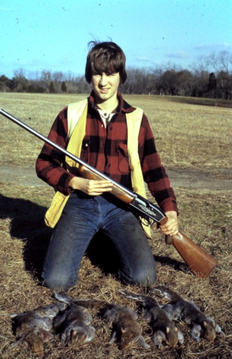 A vintage photograph of a boy with shotgun and a limit of squirrels taken after a morning of squirrel hunting in Maryland