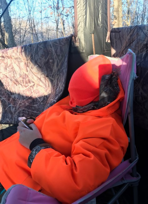A Young Wisconsin Whitetailed Deer Hunter reacts to missing a buck...by Pulling His Hat Over His Head and Texting On His Phone.