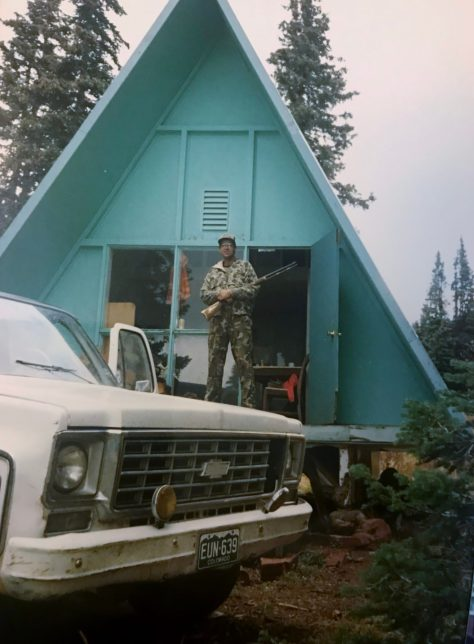 An elk and mule deer hunter in northwestern Colorado poses on the deck of a small hunting cabin, somewhere on Red Table Mountain in the mid 1980's. Michael Patrick McCarty
