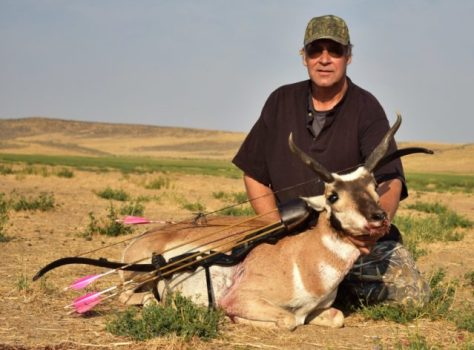 A Hunter Poses With A Pronghorn Antelope Buck, Taken In Northern Colorado With a Hoyt Satori Recurve, Easton Axis Traditional Carbon Shafts, and A Helix Single Bevel Broadhead From Strickland's Archery. Photograph By Michael Patrick McCarty