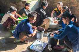 Students washing breakfast dishes