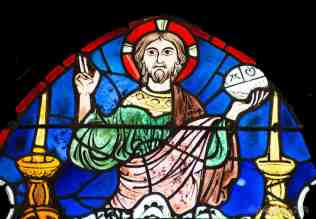 Jesus, the Alpha and Omega, blesses (top of window)
