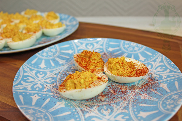 3 deviled eggs on a plate