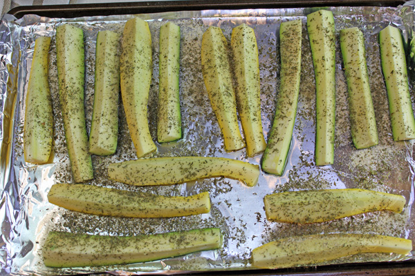 Squash and Zucchini Spears with oil and seasonings, ready for the oven.