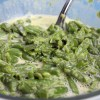 Close up of a bowl full of Cheesy Green Beans.
