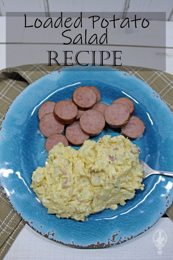 Overhead view of a blue plate with a serving of potato salad and sliced turkey sausage.