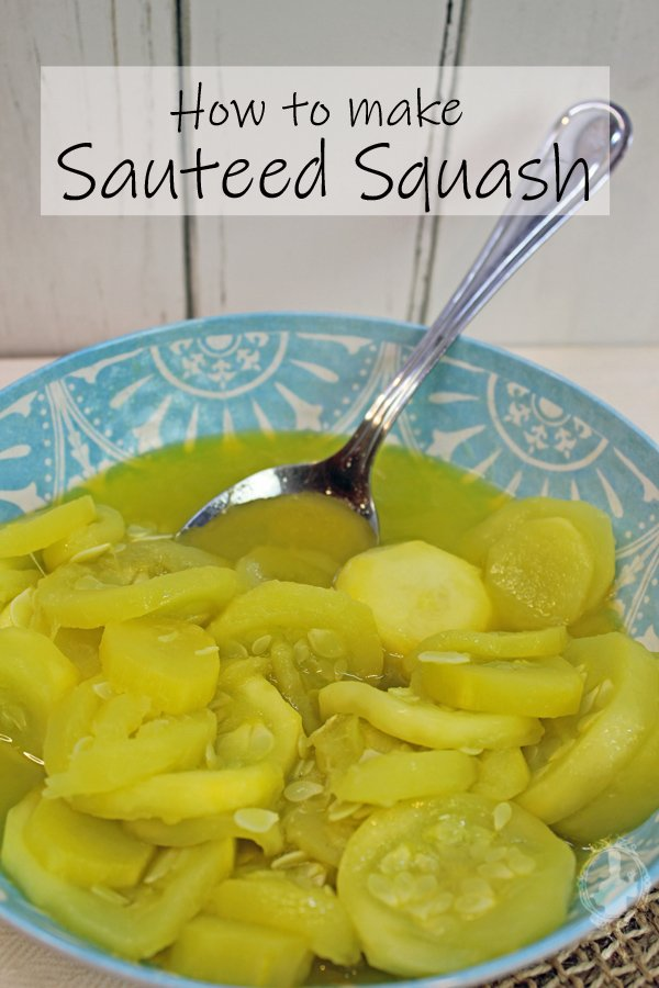 Close up of sauteed squash in a serving bowl with a silver serving spoon.