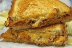 Close up of two halves of Sloppy Joe Grilled Cheese