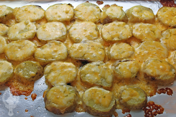 Sliced potatoes just out of the oven with melted cheese on top.