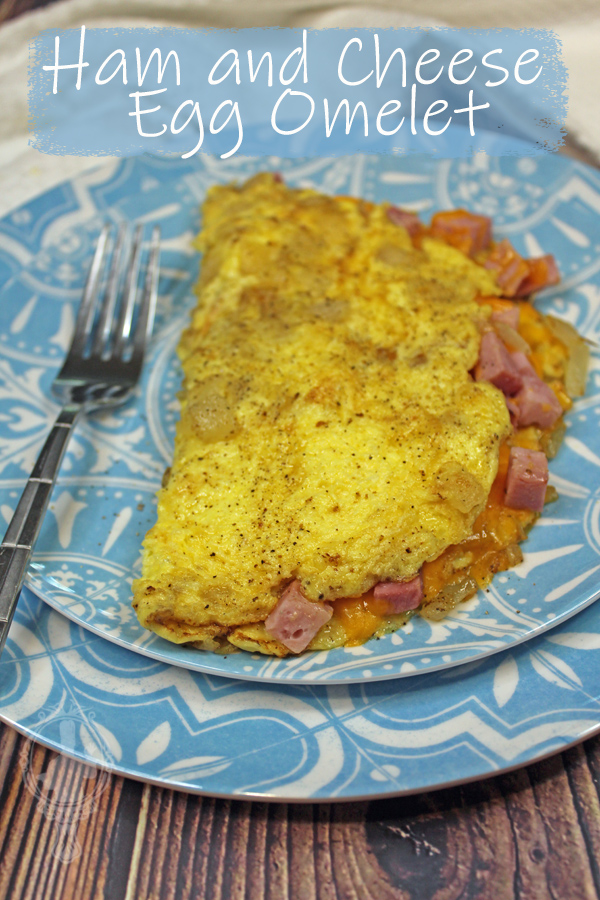 Ham and Cheese Omelet on a plate with a fork ready to dive in.