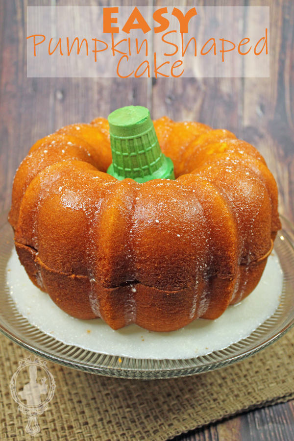 Pumpkin Shaped Cake on a cake stand.