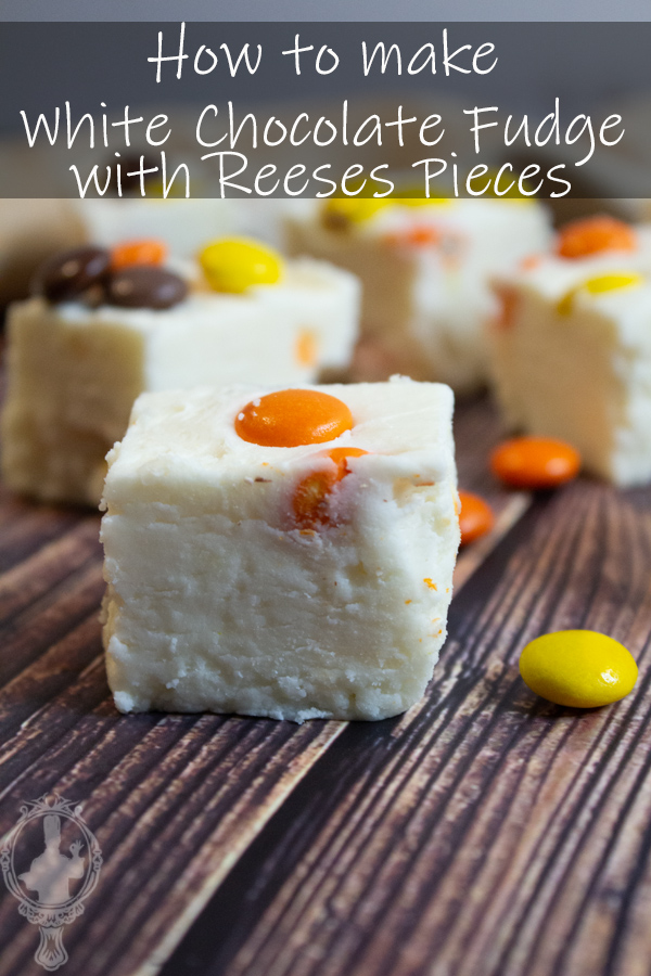 Close up of a chunk of Reeses Pieces White Chocolate Fudge