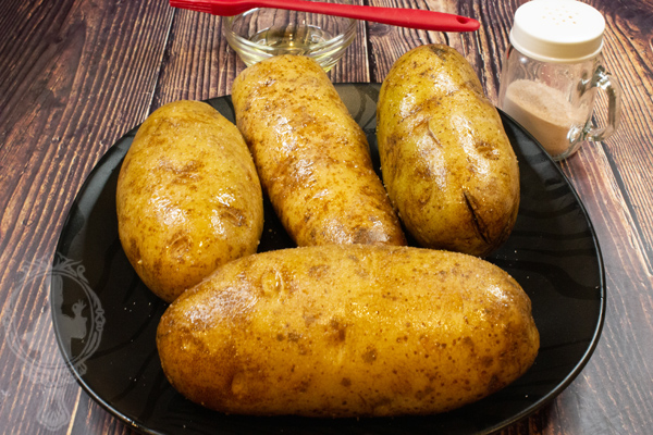Potatoes with oil and salt on outside.