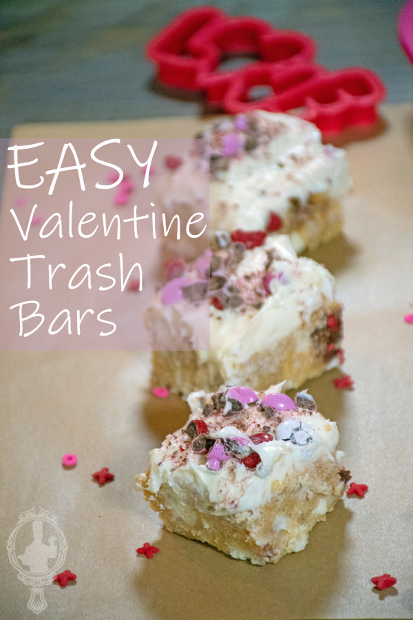 # Valenine trash bars lined up on parchment paper with sprinkles all around.