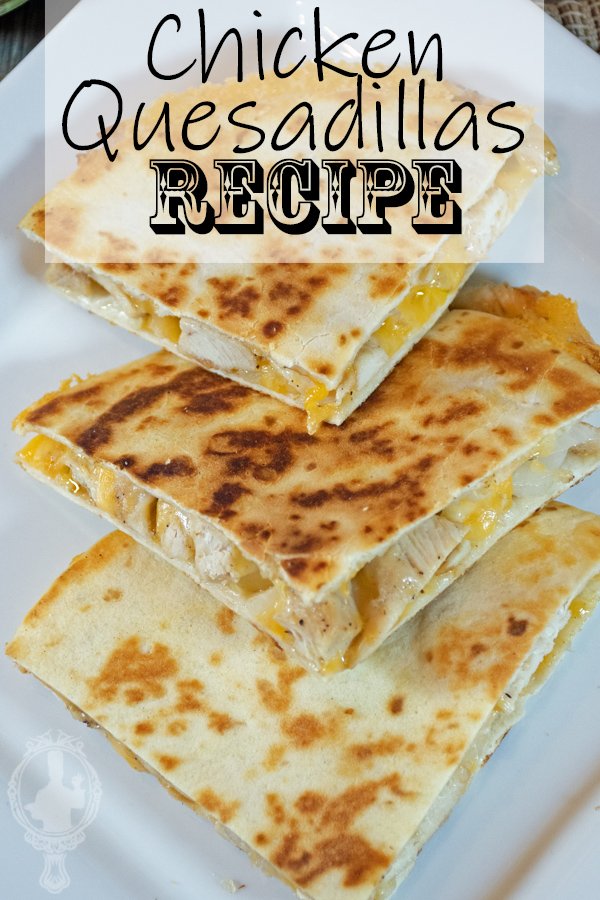 3 chicken quesadillas wedges on a white plate.