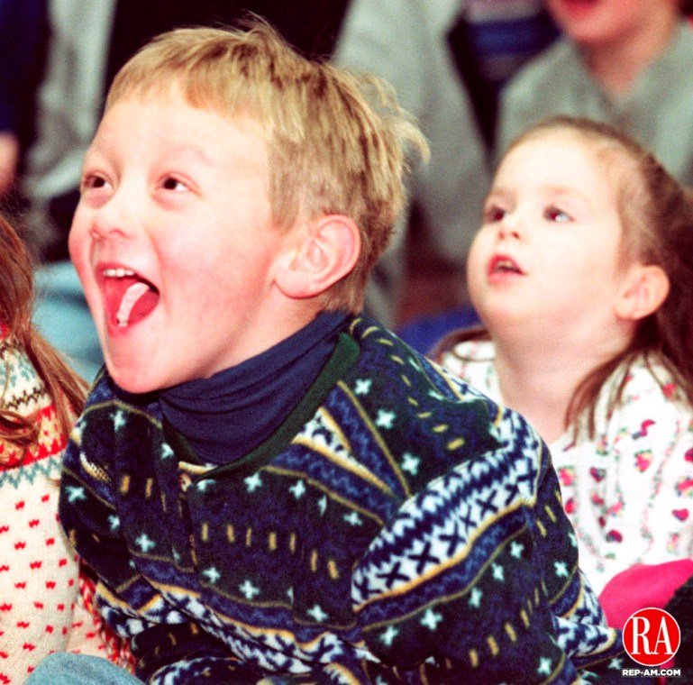 TORRINGTON, CT 12/31/98--1231DC04tif  Raymond Cswerko of Torrington laughs at a juggler during one of the many skits held 31 Dec at Torringtons First Night Festival 31 Dec. First Night is a series of events celebrating the New Year.-DOUG COLLIER staff photo (Filed in Scans/Scan-In)