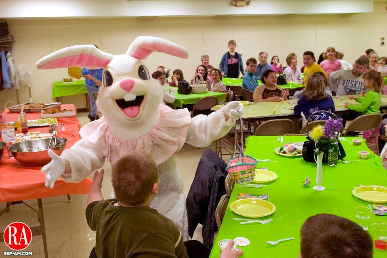 TORRINGTON, CT- 26 MARCH 2005-032605J02--Daniel Martin, 10, of Torrington, gets a hug from the Easter bunny on Saturday during the annual lunch and Easter egg hunt at the Center Congregational Church in Torrington. The event is sponsored by the Center Congregational Church