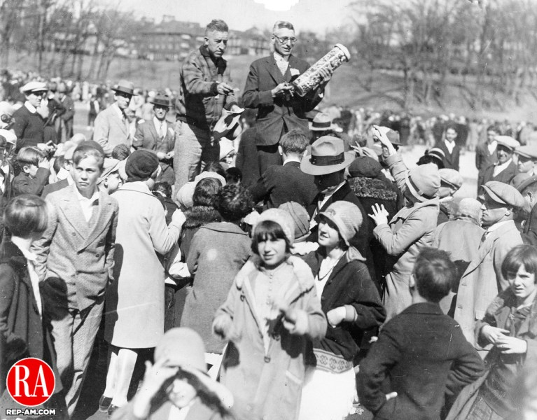 A crowd of local children wait for their name to be drawn for the jar of candy at the Easter egg hunt at Hamilton Park in 1928.