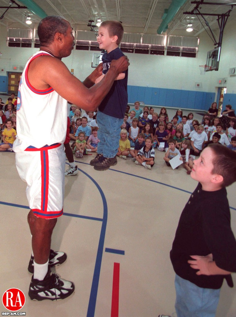 SEYMOUR, CT 09/17/98--0917CA02.tif  Tojo Henderson from the Harlem Wizards raises Alexander Matosian 4, from Seymour to his eye level during an inspirational and motivational program at Bungal Elementary School. The boy to the right is unidentified.--CRAIG AMBROSIO staff  / STAND ALONE PHOTO  (Filed in Scans/Scan-In)