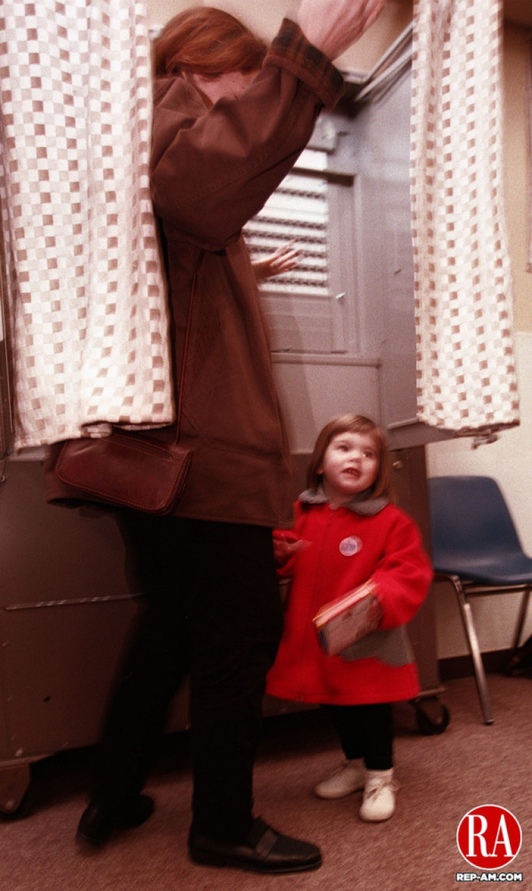 SOUTHBURY - 11/3/98 - Caroline Henebry, 2, of Middlebury walks out of the voting booth with her mom Susan Tuesday afternoon after voting for their candidate in the 131st district.  Voters packed the Shepardson Community Center in Middlebury. Photo by Michael Asaro Republican-American