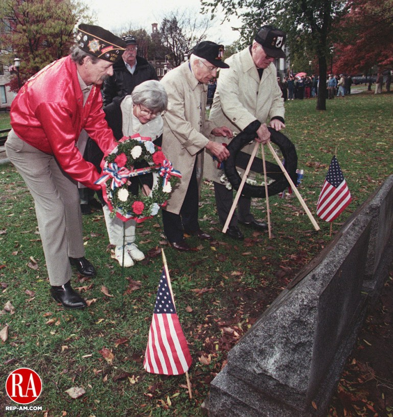 WATERBURY - 11/11/98 - (left to right) Paul Carpentier of Waterbury and Doris Maitland of Winsted place a wreath at the MIA monuments on the Waterbury Green during Veterans Day ceremonies. Doris Maitland