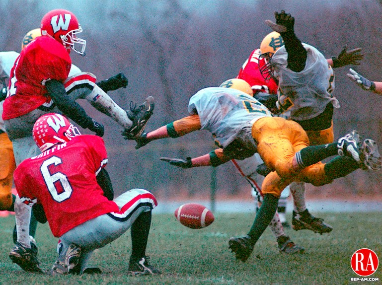 Wolcott - 11/26/98 - #21 Jeff Roy of Wolcott Eagles fails a field goal attempt as Holy Cross Players rush in. Wolcott was still victorious beating the Crusaders 6-0 at the annual Thanksgivig Day game. Jonathan Wilcox Republican-American