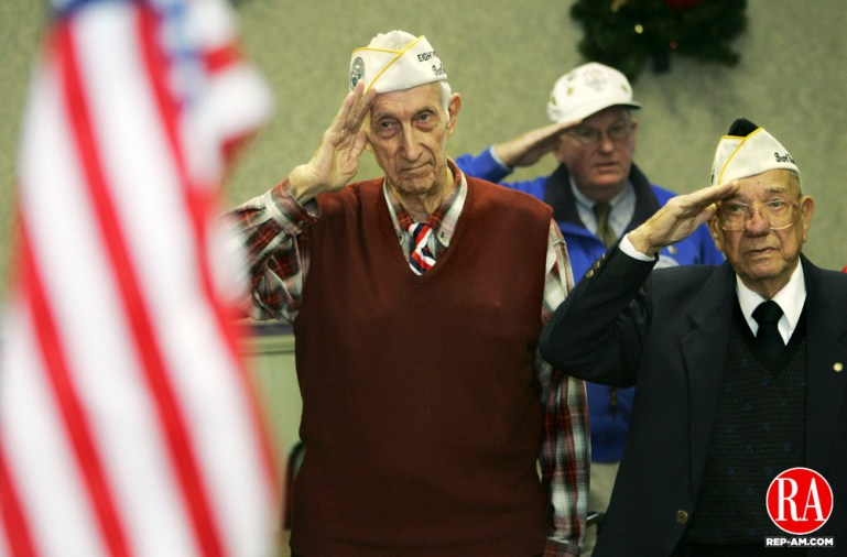 December 7, 2005 - WATERBURY - Pearl Harbor Survivors Art Schreier, of Watertown, left, and Harold Slater, of Manchester, right, salute during the playing of Taps during a Pearl Harbor Remembrance Day program in Waterbury. Schreier was a sailor on the destroyer U.S.S. Henley and Slater was a member of the 64th coast artillery, battery C. Photo by Jamison C. Bazinet Republican-American