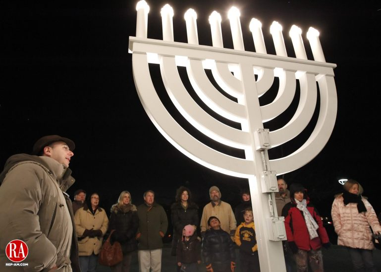 Southbury, CT- 08, December 2010-120810CM02 Rabbi Eric Polokoff (left)  leads the lighting celebration of the Menorah Wednesday night at B