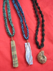 From left to right: richolite, kyanite, and ammonite necklaces
