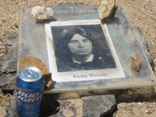 The man in the photo was 19 when he died. His grave site was right next to the other one with a Bud Light left as an offering.