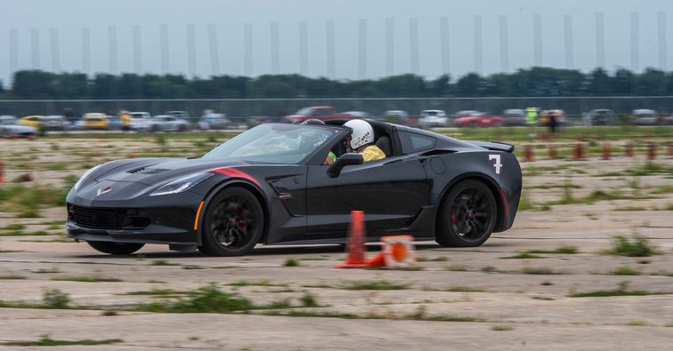 Dean Plumadore pilots his Corvette on an autocross course.