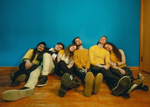 Color group photo of pop punk band, City Mouth. Blue background