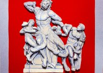 """Cover art for Premium Heart's album, """"Kosciuszko""""; features super imposed image of the sculpture, """"The Laocoon Group"""" over a solid bright red background"""