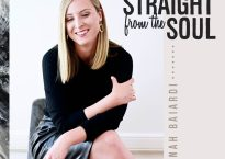 "Cover art for Hannah Baiardi's album, ""Straight from the Soul""; Photo of woman in black clothing, positioned to the left of black text that reads ""Straight from the Soul"""