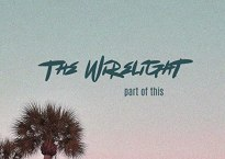 """Cover art for the single """"Part of This"""" by The Wirelight. Image depicting a color gradient that moves from gray-green to light pink from top to bottom. Dark green text reads """"The Wirelight, Part of This"""""""